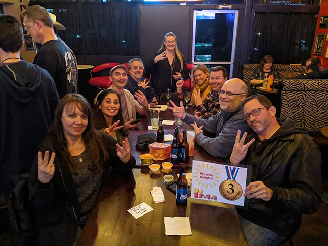 DJ Trivia Polo Lounge team showing off a 3rd placee win