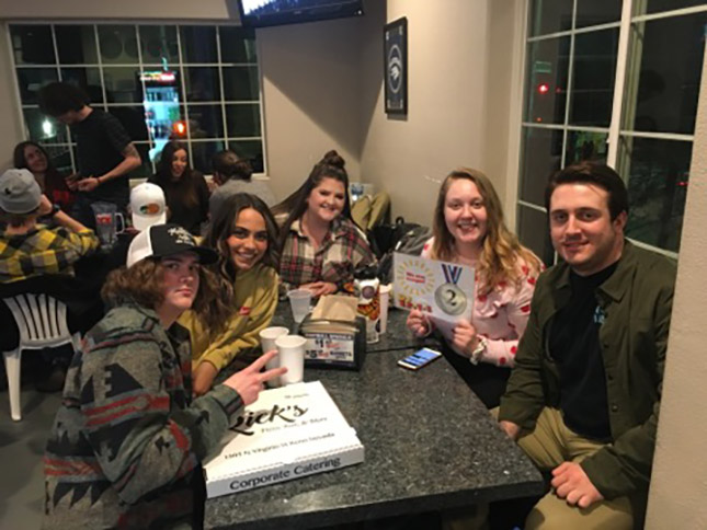college trivia night team enjoying DJ Trivia at Rick's Pizza